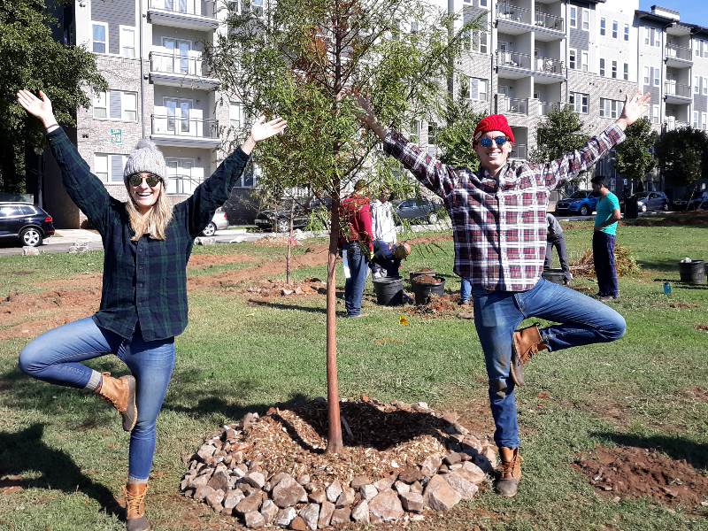 Volunteers standing near a newly planted tree